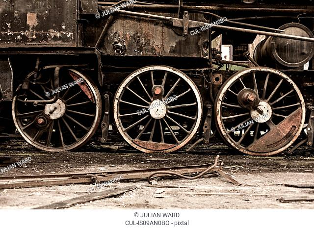Detail of steam train wheels in railway shed, Inota, Hungary