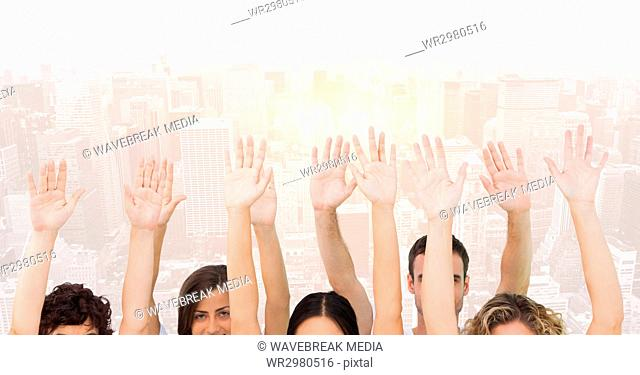 Hands up against buildings on background