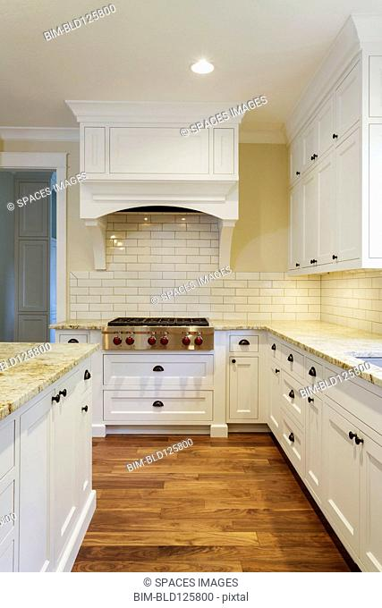 Counters and cabinets in luxury kitchen