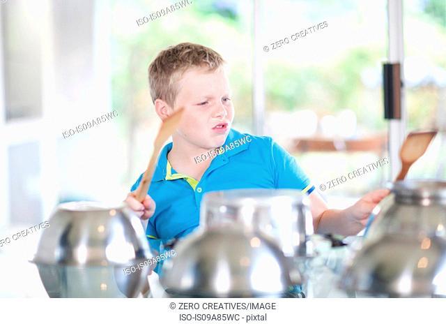 Boy pretending to be drummer