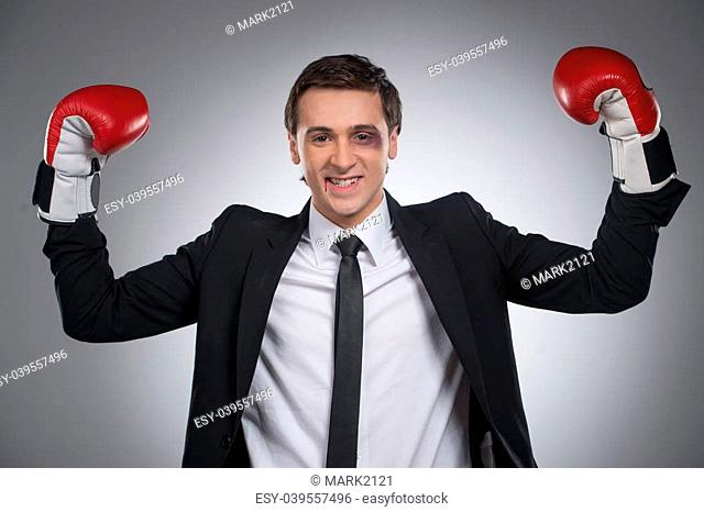 Man wins a fight. Standing happy with blood on lips