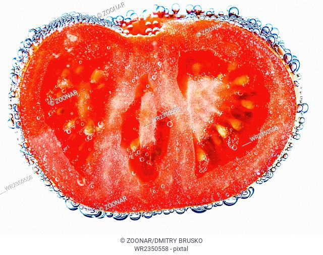 Isolated tomatoes in water