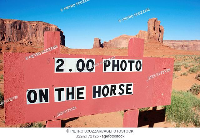 Utah/Arizona, U.S.A., sign posted by Navajos to charge tourists photographed on a horse, Monument Valley