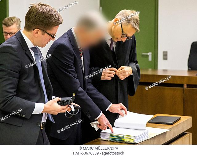 Former manager of German weapons manufacturer KMW (Krauss-Maffei Wegmann) stands next to his lawyers Philipp Falk (L)and Rainer Spatscheck in the dock of a...