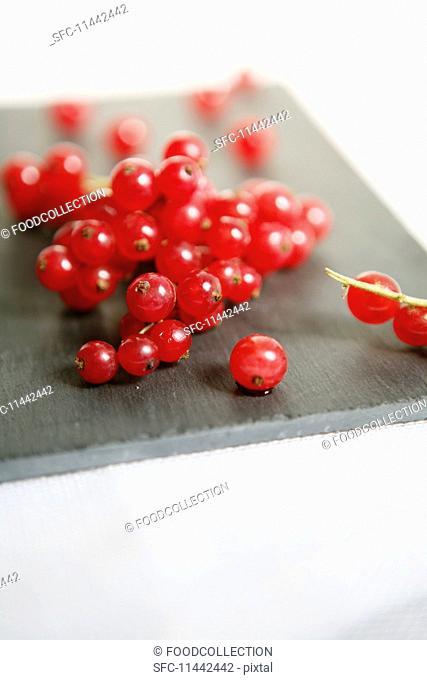 Redcurrants on a grey board