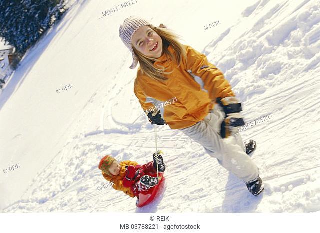 Girls, winter clothing, Bob,  Sister, sitting, pulls, snow  Children, two, 2-3 years, 6 years, childhood, season, winters, winter-fun, leisure time, fun