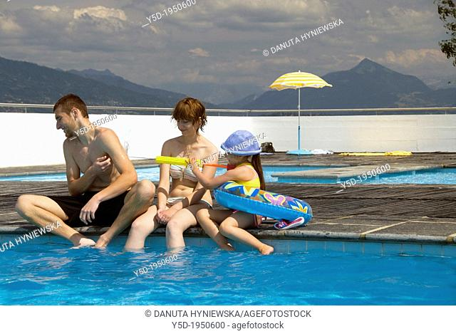 family scene at the swimming pool, summer leisure, Geneva, Switzerland