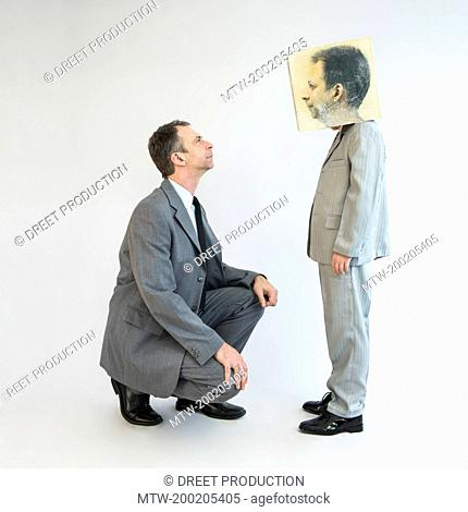 Businessman sympathizing boy wearing mask