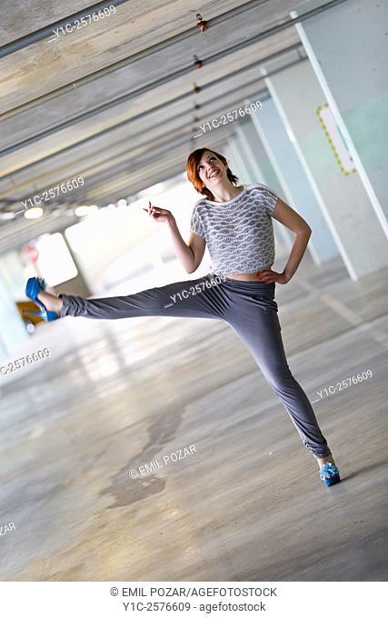 Exercising in high-heels teenager girl