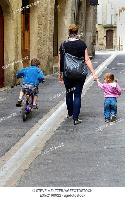 A mother walks with her children