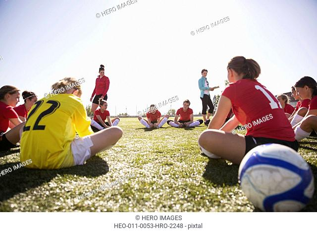 Girls soccer team stretching before game