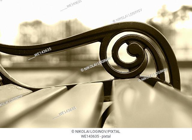 Horizontal sepia park bench bokeh background