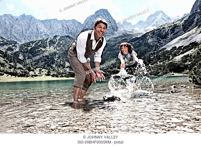 Couple splashing in lake