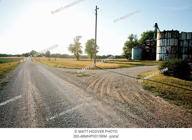 Grain silos on rural gravel road