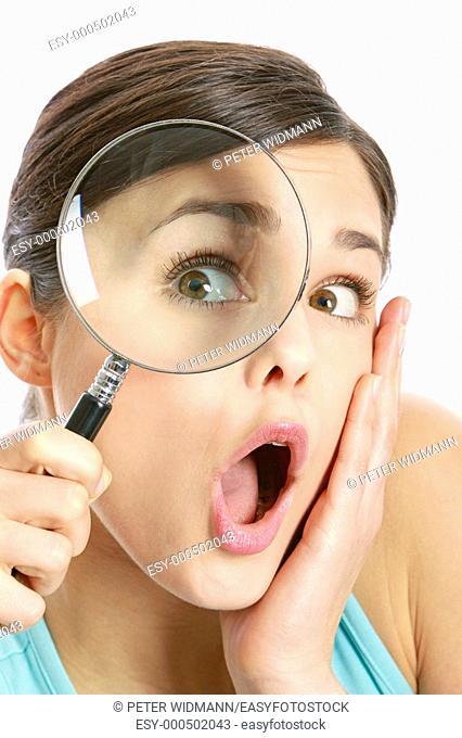 eye of a woman oversized through a magnifier glass