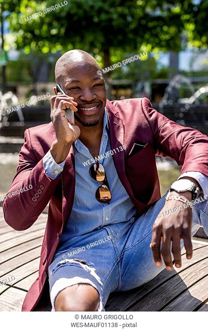 Portrait of smiling businessman on the phone
