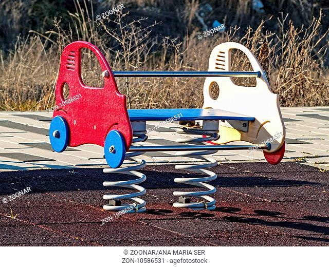 Swing of a car on an urban park