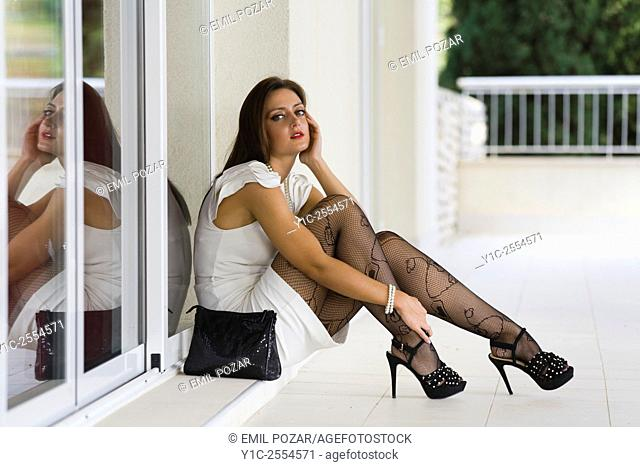 Stock Photo - Young woman fashionable in White dress
