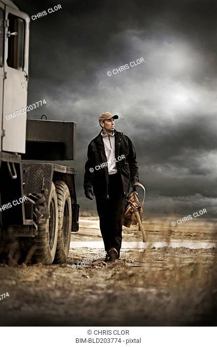 Caucasian farmer walking by truck