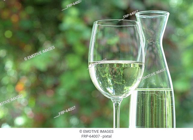 White wine in a carafeand a wine glass