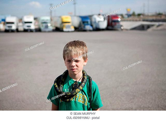 Boy with snake around his neck
