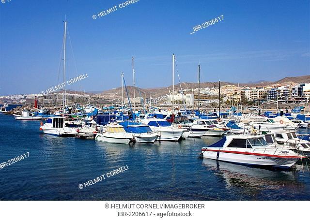 Fishing boats and pleasure crafts in the port of Arguineguin, Gran Canaria, Canary Islands, Spain, Europe, Atlantic Ocean