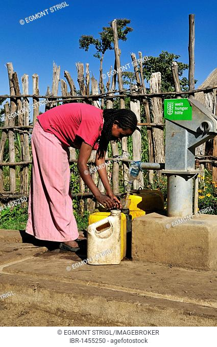 Ethiopian woman pumping drinking water at a newly built pump, Rift Valley, Oromia, Ethiopia, Africa