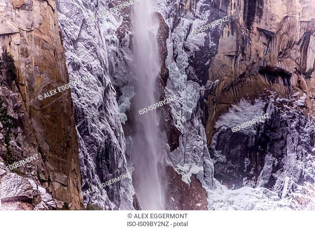 Waterfall on rock face, Yosemite National Park, California, USA
