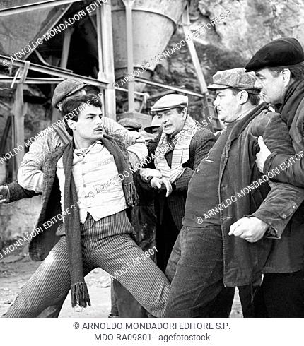 Italian actor Michele Placido being held back during a fight in The Black Hand. 1973