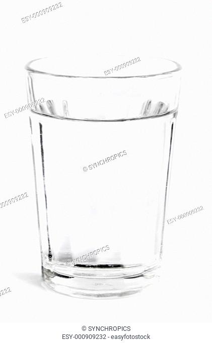 fresh cold water in a glass with white background