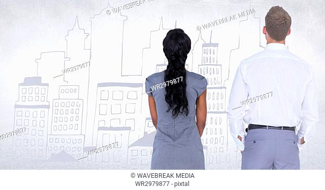 Back of business people looking at white wall with city doodle