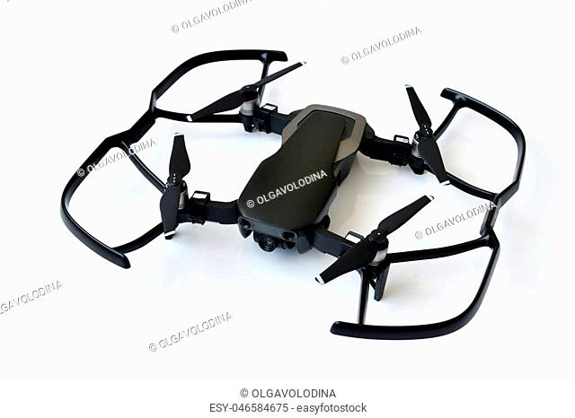 Black quadrocopter with the protection of screws on a white background