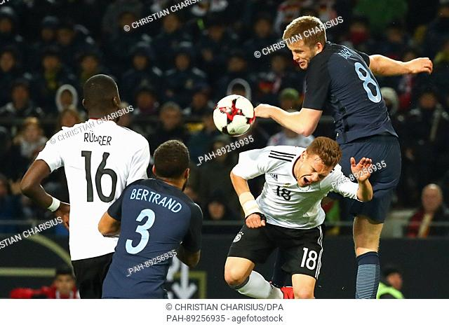 Germany's Joshua Kimmich and Antonio Ruediger (L) play aginst England's Ryan Bertrand and Eric Dier (R) during the international friendly soccer match between...