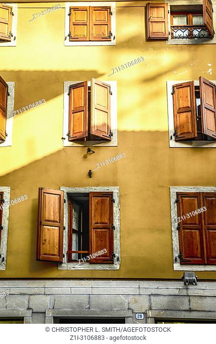 Wooden shutters keeping the sun out of the rooms in Piazza San Giacomo in Udine, Italy