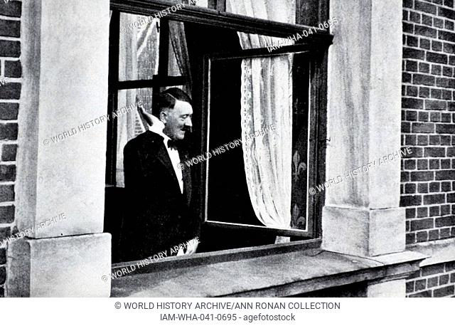 Adolf Hitler 1889-1945. German politician at a window receiving the adulation of a crowd in Bayreuth