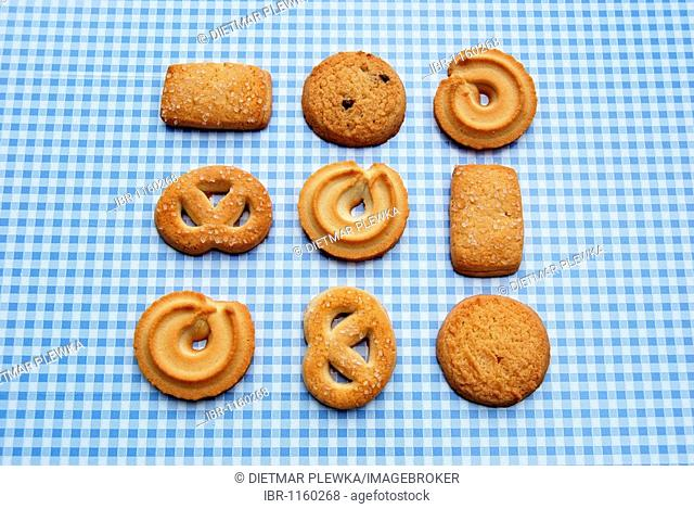 Danish butter cookies with or without sugar, pretzels, on checked tablecloth