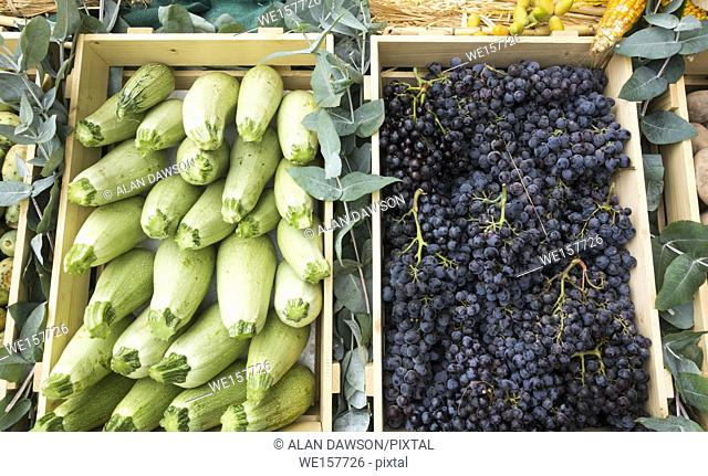 Box of courgettes and grapes on market stall on Gran Canaria, Canary Islands, Spain