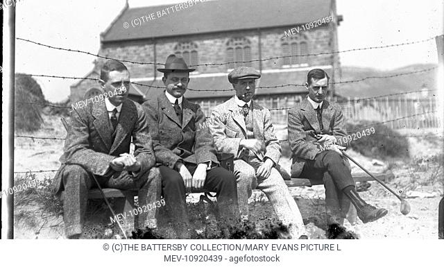 Four men on a bench at golf club, believed to be Llandudno at Whit week 1913. Second from left is the photogrpaher's brother Edgar who was to become a WW1...