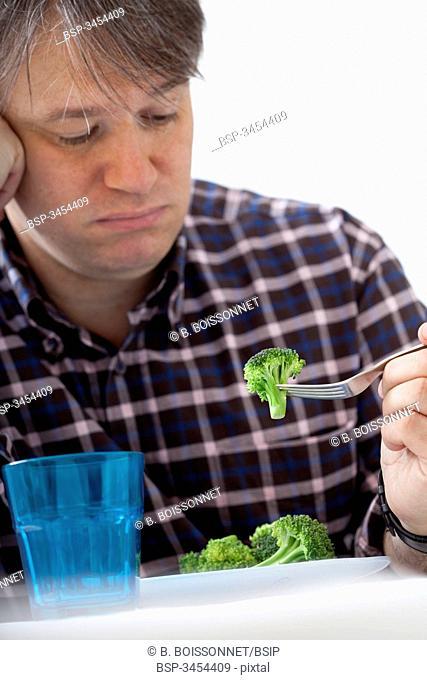 MAN EATING VEGETABLE