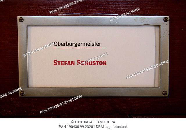 30 April 2019, Lower Saxony, Hanover: A name tag hangs on the office of Stefan Schostok (SPD), Lord Mayor of the City of Hanover, in the New Town Hall