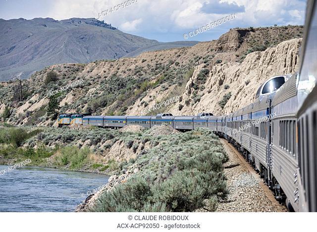 Passenger train along the Thompson River in British Columbia, Canada