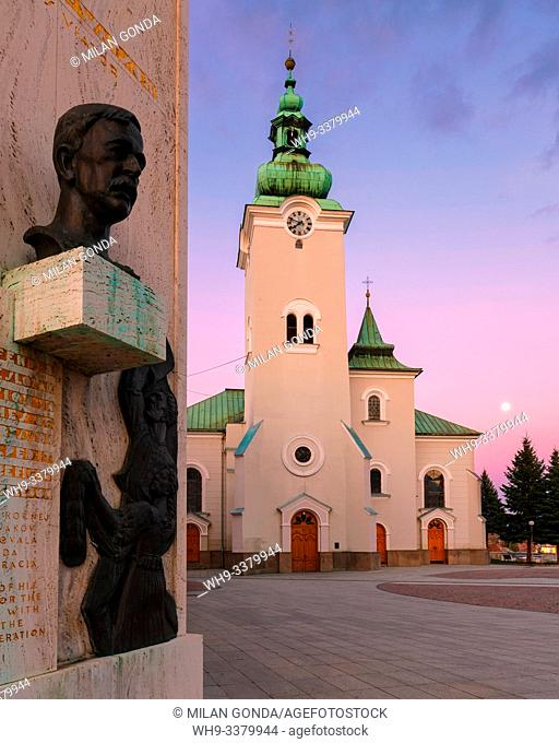 Memorial and a church in the main square of Ruzomberok. Slovakia