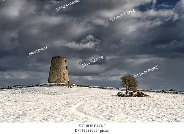 Disused windmill on a winter's day, snow clouds approaching; Cleadon, Tyne and Wear, England