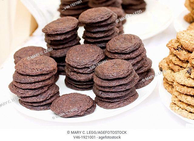 Dark Chocolate Fudge Cookies using whole grains in famer's market  Enticing chocolate cookies on a plate in a baked goods stall  It is a fresh market with bio...
