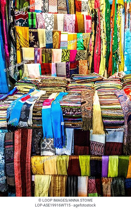 A scarf and textile stall at the night market or souk in Luxor in Egypt