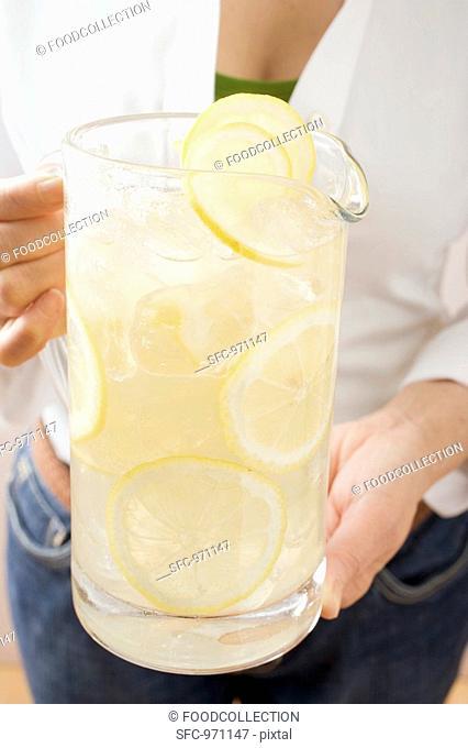 Woman holding a jug of lemonade