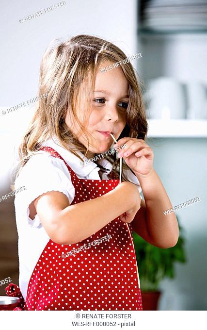 Germany, Girl eating noodles