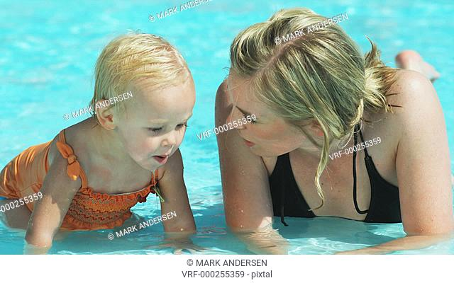 mother and daughter in a pool