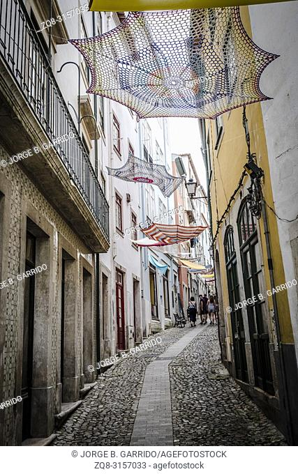 People wlaking at the streets of Coimbra, Portugal