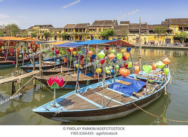Lantern boats and traditional fishing boats on Son Thu Bon River, Hoi An, Quang Nam Provence, Vietnam, Asia